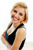 Young fit woman with arms folded Stock Photos