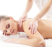 A young and fit woman on a back massage procedure Stock Photography