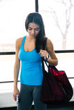 Young fit woman with bag in gym Royalty Free Stock Image