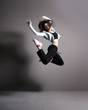 A young and fit woman dancing in sporty clothes Stock Photography