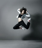 A young and fit woman dancing in sporty clothes Royalty Free Stock Photo