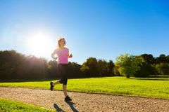 Young fit woman does running, jogging training Royalty Free Stock Photos