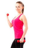 Young fit woman doing exercises Stock Photos