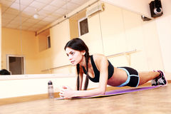 Young fit woman doing fitness exercises Stock Photos