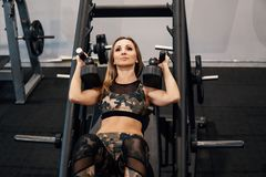 Young fit woman doing workout exercise in gym royalty free stock images