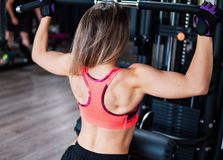 Young fit woman doing workout exercise in gym stock photos