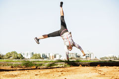 Young fit woman doing simple acrobatics exercise Royalty Free Stock Images