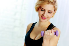 Young fit woman doing workout with dumbbell Royalty Free Stock Photo