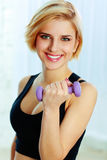 Young fit woman doing workout with dumbbell Stock Photos