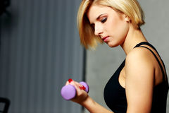 Young fit woman doing workout with dumbbell Stock Photo