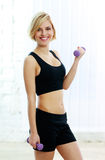 Young fit woman doing workout with dumbbell Stock Photography
