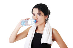 Young fit woman drinking mineral water Stock Image