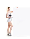 Young and fit woman with a dumbbell Stock Photography