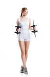 Young and fit woman with dumbbells Stock Photos