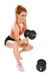 Young fit woman with dumbbells Royalty Free Stock Photography