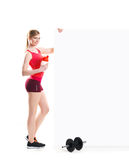 Young and fit woman with dumbbells Royalty Free Stock Photo