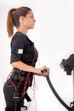 Young fit woman exercise on electro muscular stimulation machine Stock Images
