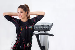 Young fit woman exercise on electro muscular stimulation machine Royalty Free Stock Photography