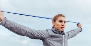 Young and fit woman exercising with resistance band Stock Photos