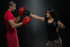 Young Fit Woman Fighting A Man Stock Photos