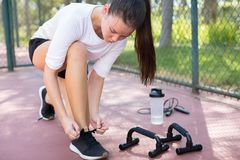 A young fit woman getting ready to exercise at park royalty free stock images