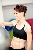Young fit woman at the gym Stock Photo