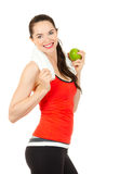 Young fit woman holding apple Royalty Free Stock Photography
