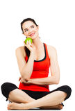 Young fit woman holding apple Stock Photography
