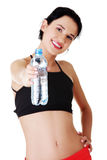 Young fit woman holding bottle of water. After fitness exercise Royalty Free Stock Photography