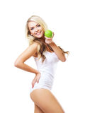 Young and fit woman holding a fresh green apple Stock Photography