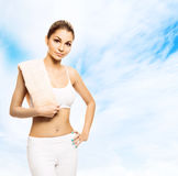 Young and fit woman holding a towel after a workout Royalty Free Stock Image