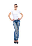 Young and fit woman in jeans isolated on white Stock Photos