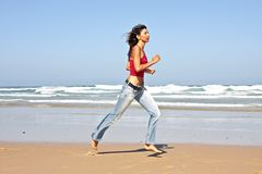 Young fit woman jogging Stock Photo