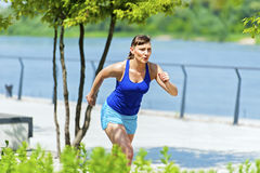 Young fit woman jogging in the city park. Stock Photography