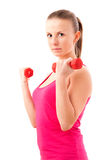 Young fit woman lifting dumbbells Stock Image