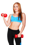 Young fit woman lifting dumbbells on white background royalty free stock images