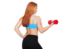 Young fit woman lifting dumbbells on white background royalty free stock photo