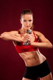 Young fit woman lifting dumbell Stock Photos