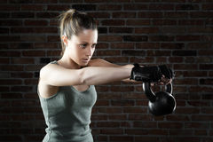 Young fit woman lifting kettle bell Stock Image