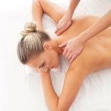A young and fit woman on a massage procedure Royalty Free Stock Images