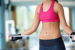 Young fit woman measuring belly Royalty Free Stock Images