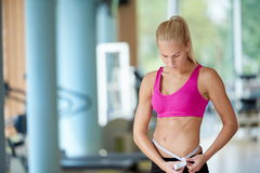 Young fit woman measuring belly Stock Photography