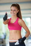 Young fit woman measuring belly Royalty Free Stock Photos