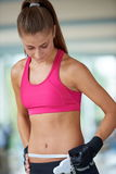 Young fit woman measuring belly Stock Image