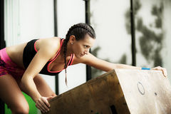 Young fit woman. Is moving jumping box Royalty Free Stock Images