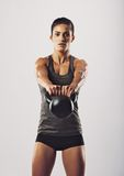 Young fit woman performing kettlebell swing exercise Royalty Free Stock Photos