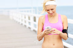Young fit woman with phone Stock Photography