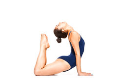 Young fit woman practicing yoga, stretching in cobra position Royalty Free Stock Photo