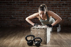 Young Fit Woman Pushing Up On Brick Background Stock Photos