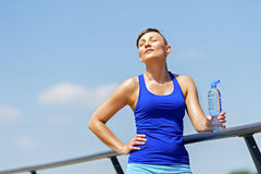 Young fit woman resting after jogging. Stock Photos